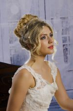Model Wears Birdcage Veil with Chenille Dots