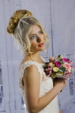 Model wears tulle Birdcage veil