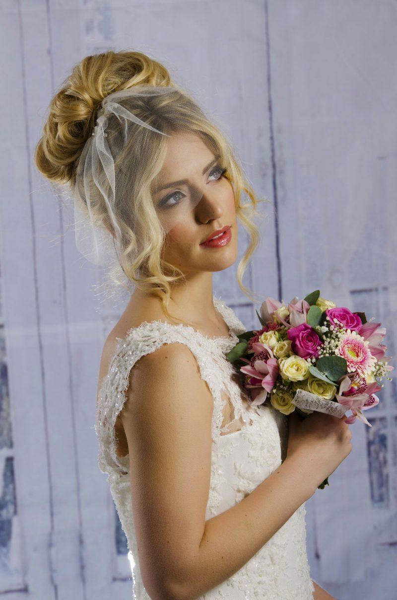 Model wears tulle Birdcage veil
