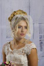 Model wears Face visor birdcage veil.