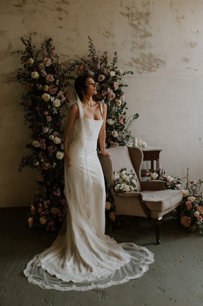 lace wedding veil, model wears long wedding veil showing the ivory scalloped and central motif detail