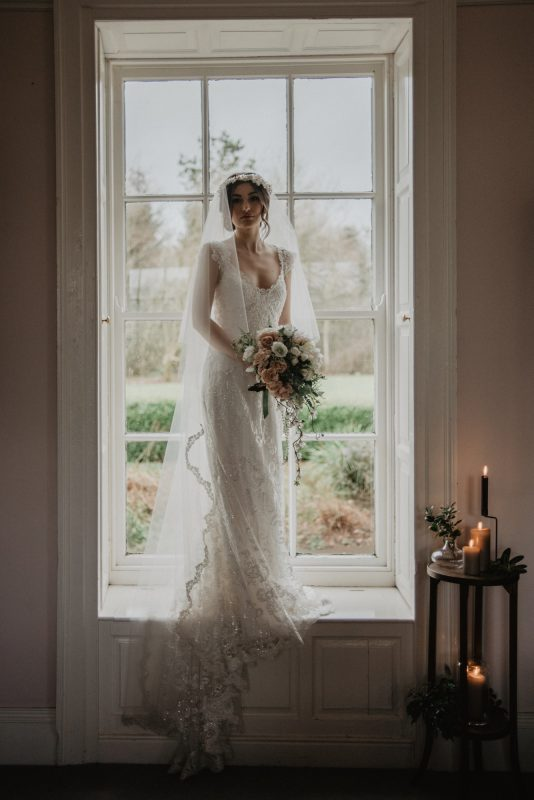 Silver metallic lace edging model is wearing Cathryn Veil at BreckenHill House