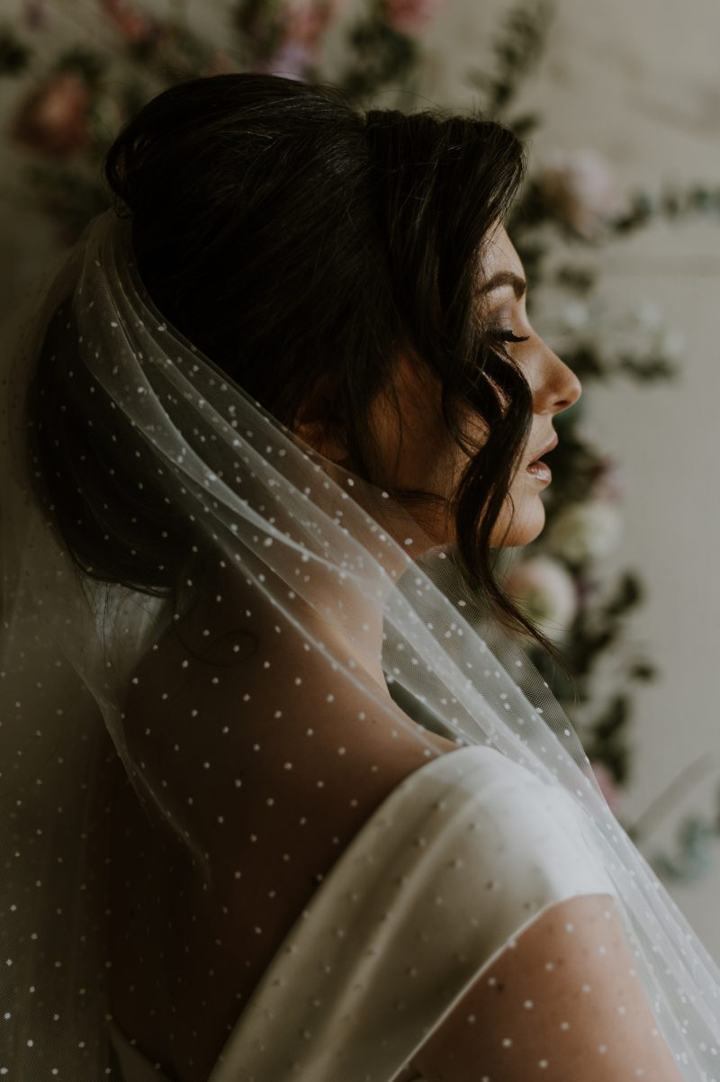 Polka dot veil for wedding, shown from the side of the head