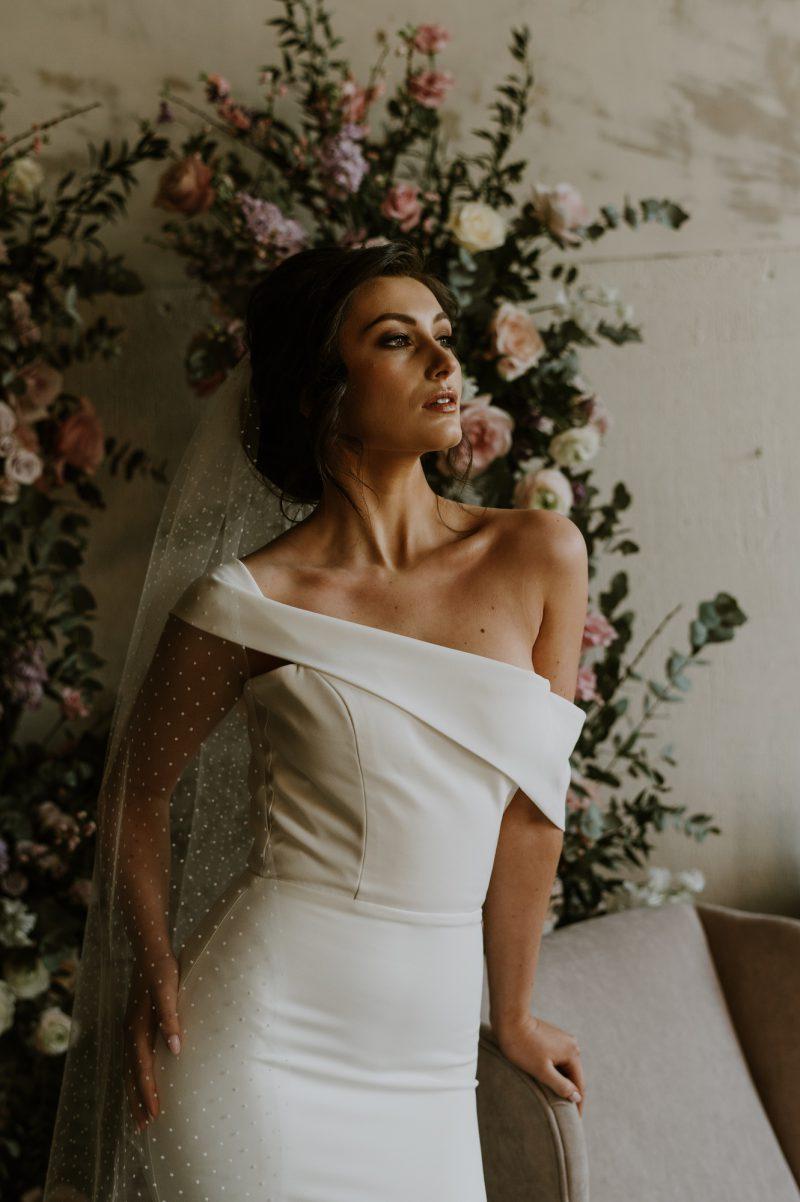 Polka dot veil for wedding, model wears the veil behind the head