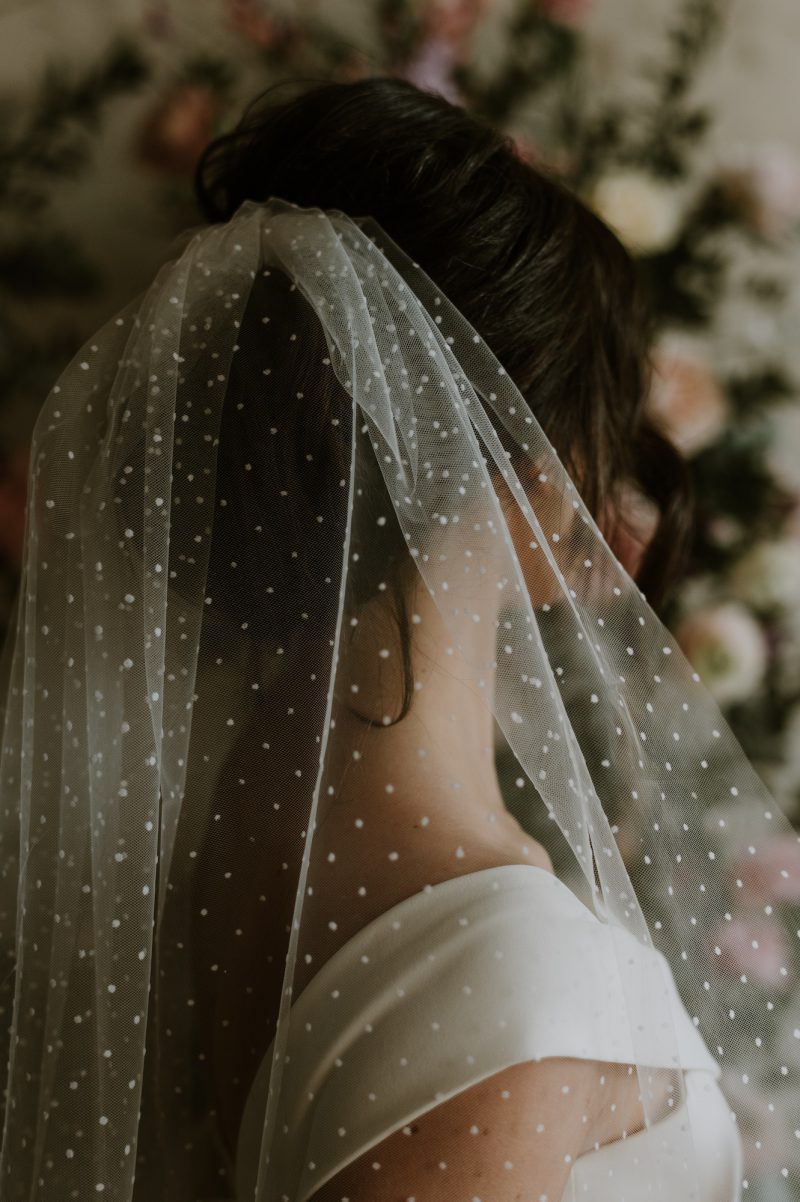 Polka dot veil for wedding , models wear the back view o