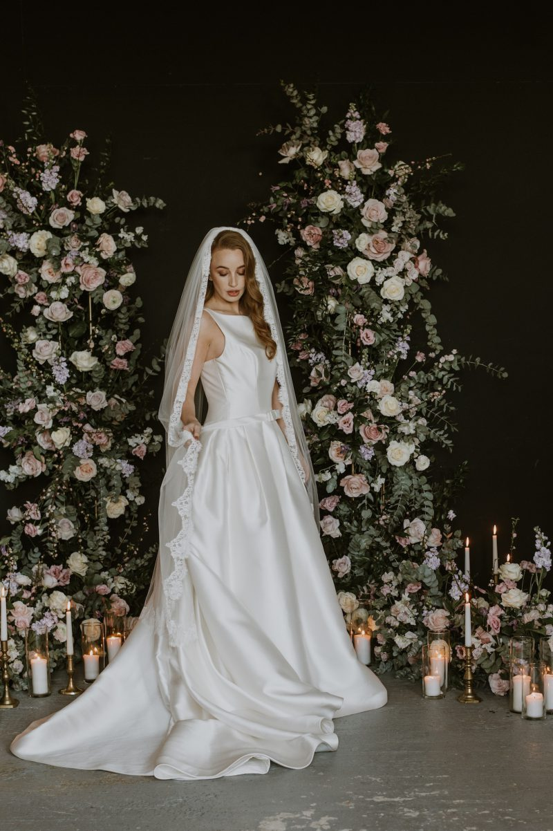 lace wedding veil, models shows the veil worn from the side.
