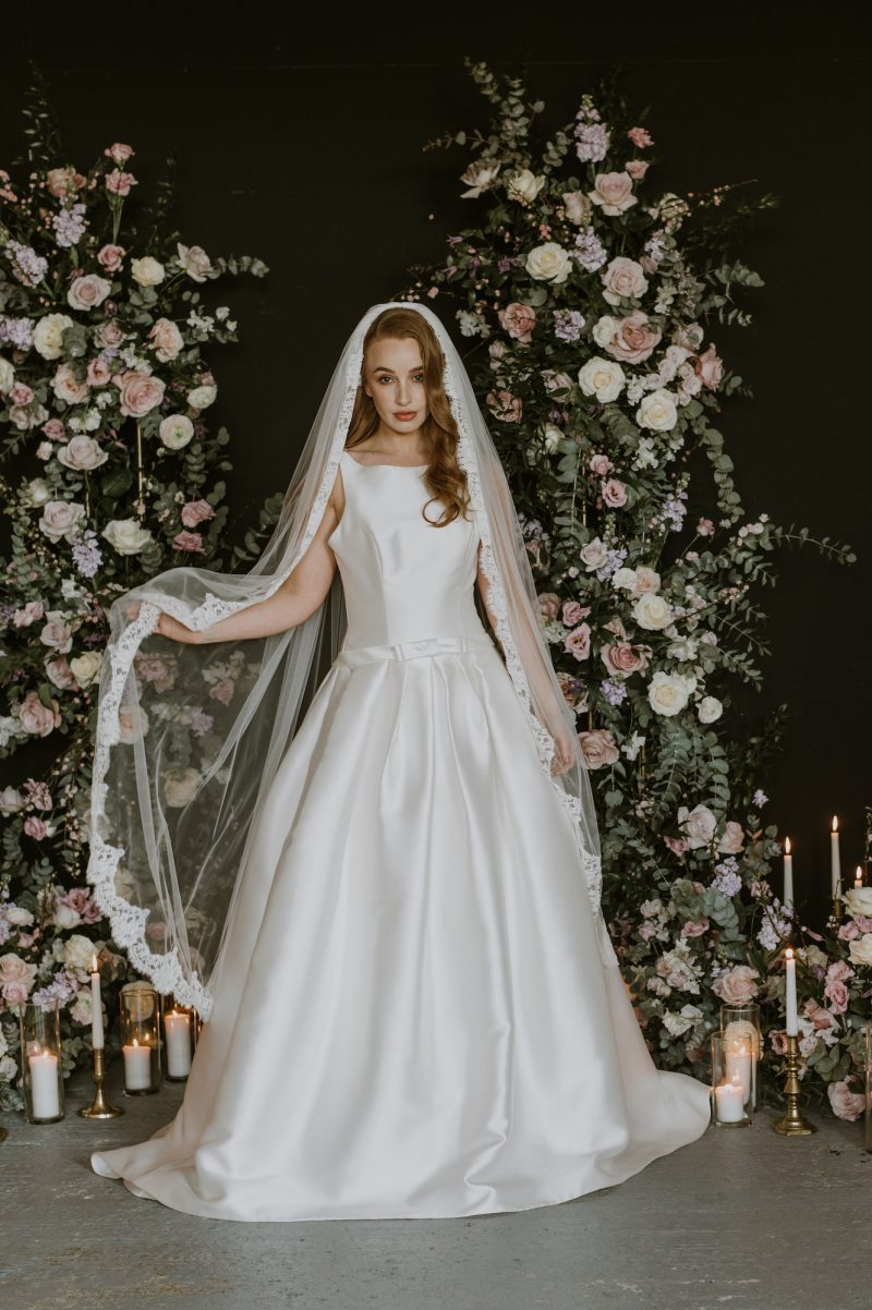 lace wedding veil, model wear our Claire veil shown from the side.