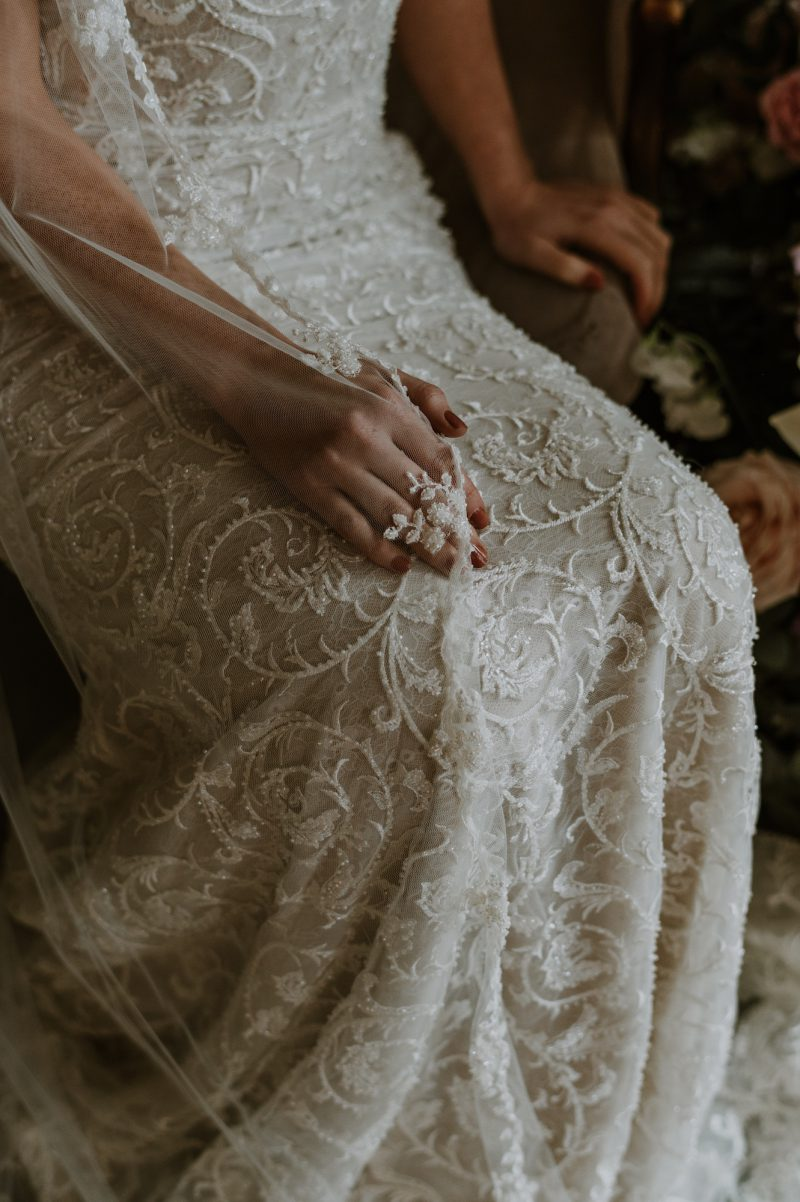 Ivory beaded veil, gorgeous detail draped though our models hand.