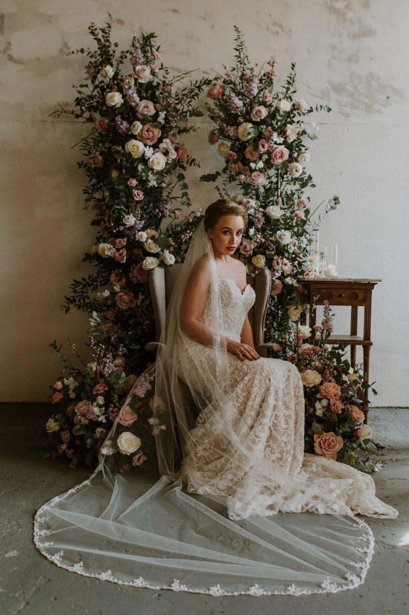 Model wear a floral beaded long wedding veil.