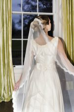 model wear silk and lace mantilla veil, Elena