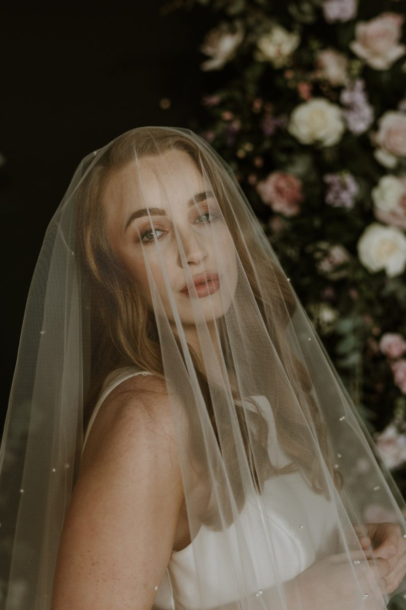 Pearl veil uk, wedding veil blusher worn over the face. Model wear our Elizabeth veil.