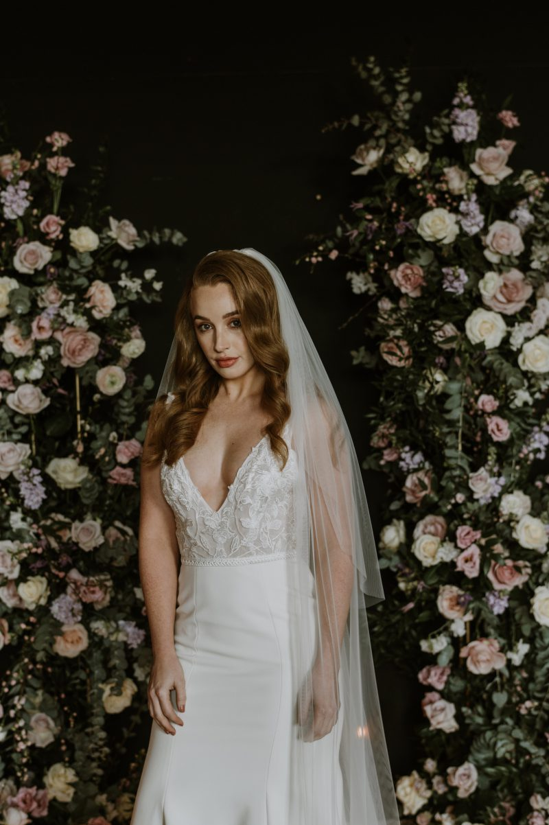 Wedding veil blusher, model wears the blusher layer on the Fleur veil
