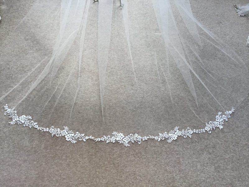 lace flower motif wedding veil, Freesa, adorns the tailpiece of our wedding veil diplayed in our Visionary Veils studio.