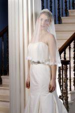 Model wears a silk tulle lace wedding veil