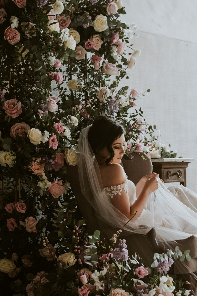 3D flower veil worn by model sitting in the chair
