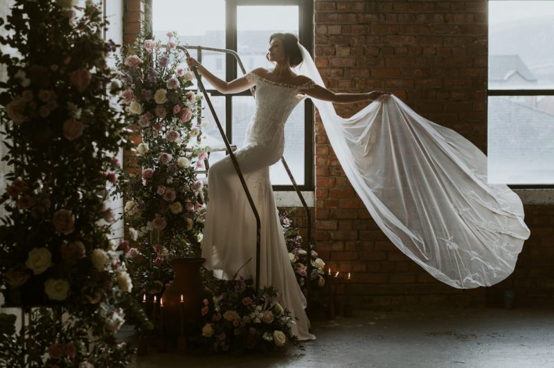 floral embroidered veil , model on ladder wears Monroe veil,