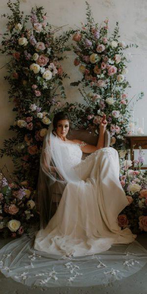 3D flower veil , Monroe veil worn by model sitting in the chair