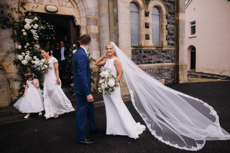 Lace wedding veil, bespoke veil worn by Visionary Veils Real bride, outside the church.