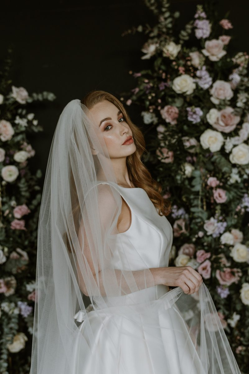 Ivory beaded wedding veils, model wears the Roberta wedding veil