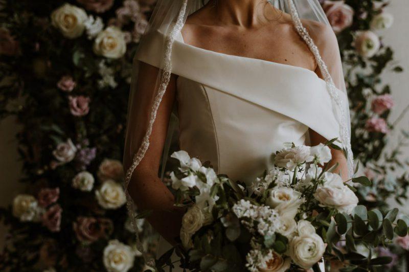 beaded veil trim, Sarah veil worn by model with classic flowers