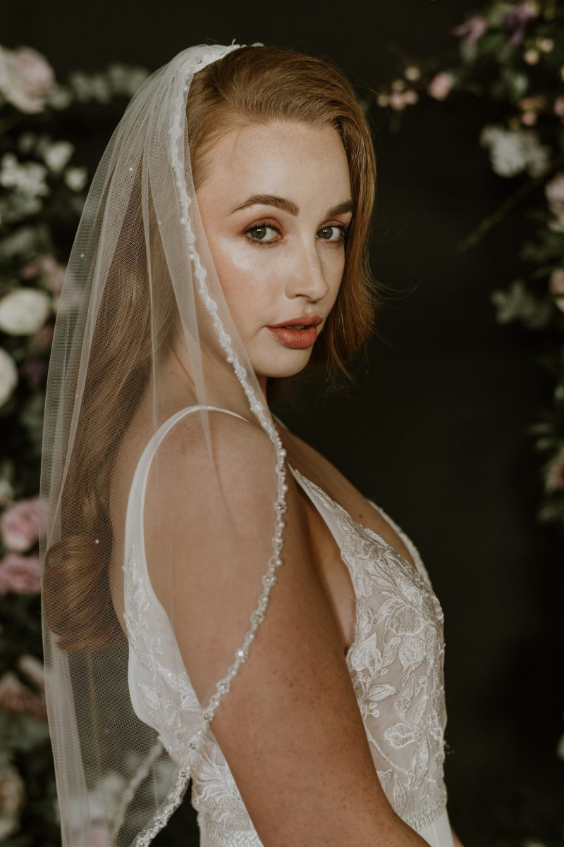 Pearl beaded veil, waist length veil worn by model