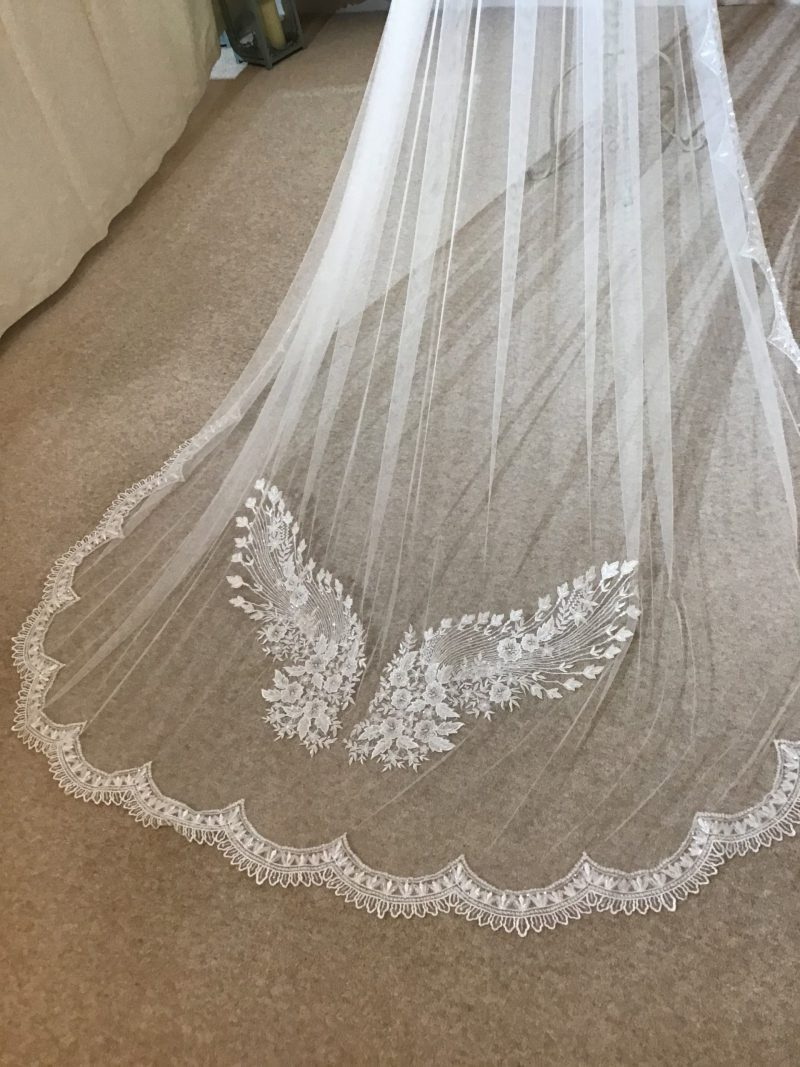 Lace wedding veil, with angel central detail in Visionary Veils studio